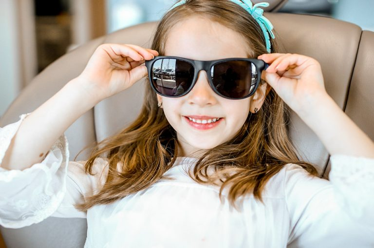 Girl smiling with sunglasses