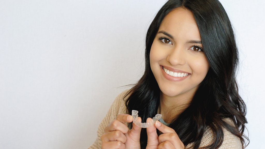 girl smiling with invisalign