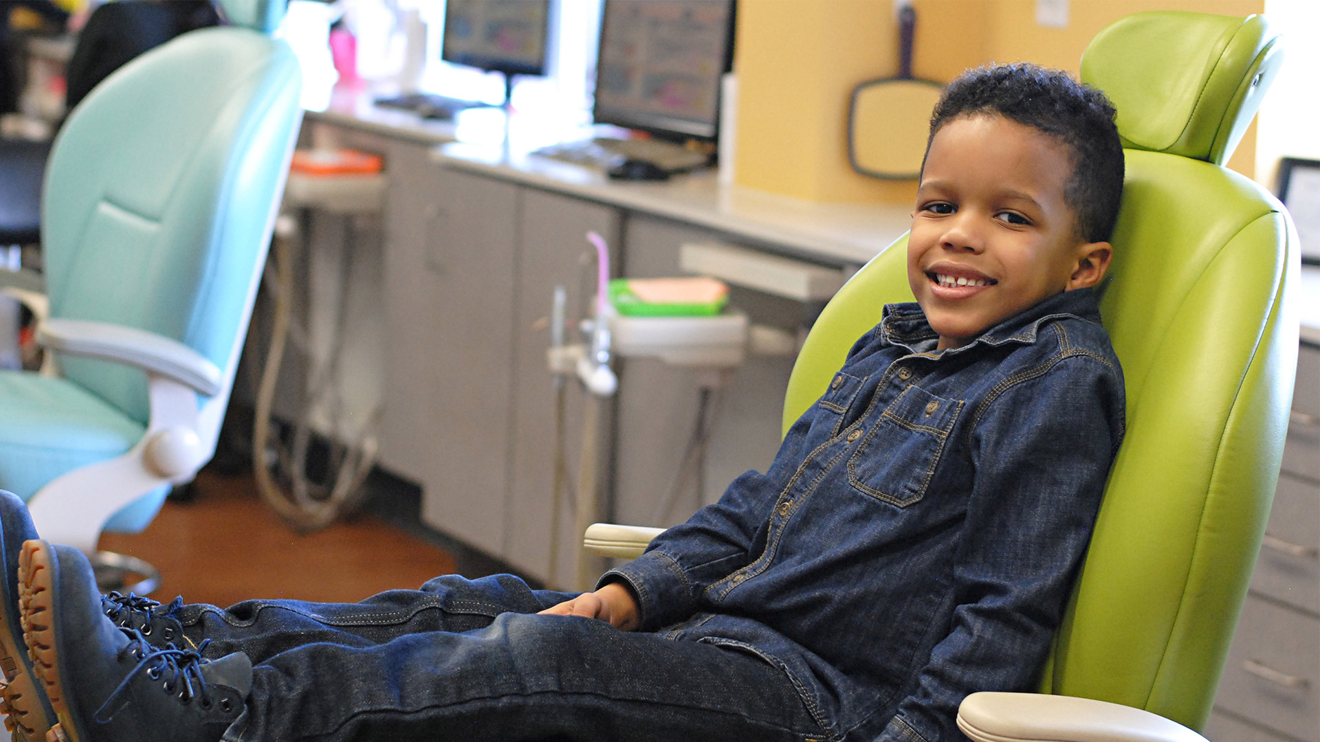 child smiling in chair